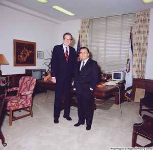 "[""Senator John D. (Jay) Rockefeller and Senator Daniel Inouye pose for a photograph in his Washington office.""]%"