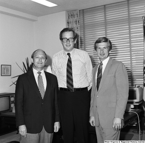 "[""Senator John D. (Jay) Rockefeller stands for a photograph with two unidentified guests in his Washington office.""]%"