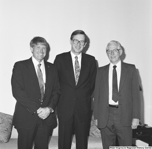 "[""Senator John D. (Jay) Rockefeller stands between two NASA scientists.""]%"