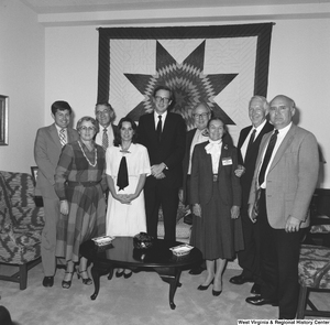 "[""Senator John D. (Jay) Rockefeller stands with representatives from the West Virginia State Medical Association in his Washington office.""]%"