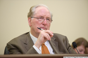 "[""Senator John D. (Jay) Rockefeller holds a pen at a September 2012 Commerce Committee hearing.""]%"