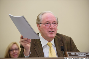 "[""Senator John D. (Jay) Rockefeller holds a report in the air during a September 2012 Commerce Committee hearing.""]%"