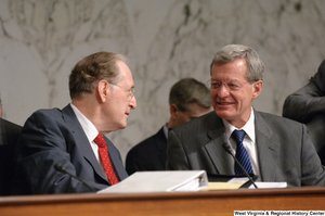 "[""Senators John D. (Jay) Rockefeller and Max Baucus chat during an executive session to consider new health care reform legislation.""]%"