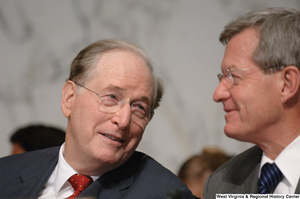 "[""Senators John D. (Jay) Rockefeller and Max Baucus talk during an executive session to consider new health care reform legislation.""]%"
