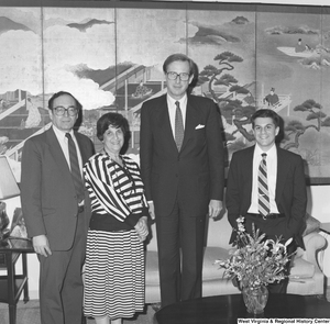 "[""Senator John D. (Jay) Rockefeller stands between three unidentified individuals in his office.""]%"