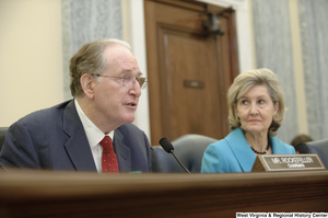 "[""Senators John D. (Jay) Rockefeller and Kay Hutchison sit at a Commerce Committee hearing.""]%"