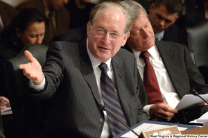 "[""Senator John D. (Jay) Rockefeller gestures to someone during a hearing about health care reform legislation in the Senate Finance Committee.""]%"