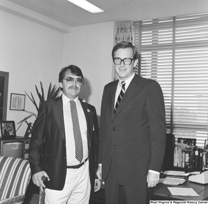 "[""Senator John D. (Jay) Rockefeller stands for a photograph in his office with an unidentified man wearing an Elks Lodge pin that reads \""Just Say No: Elks\"".""]%"