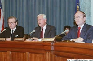 "[""Senator John D. (Jay) Rockefeller sits beside Senators Hollings and Bryan during a Commerce Committee hearing.""]%"