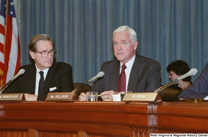"[""Senator John D. (Jay) Rockefeller looks at Senator Ernest Hollings while he speaks at a Commerce Committee hearing.""]%"