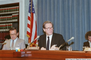 "[""Senator John D. (Jay) Rockefeller listens as someone speaks during a Senate Commerce Committee hearing.""]%"