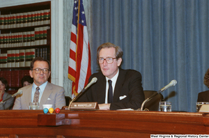 "[""Senator John D. (Jay) Rockefeller looks at the audience at a Commerce Committee hearing.""]%"