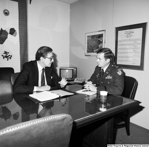 "[""Senator John D. (Jay) Rockefeller sits in his office and talks with Colonel Farewell of the Huntington Corps of Engineers.""]%"