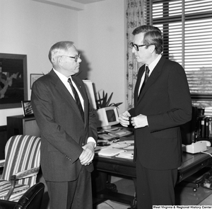 "[""Senator John D. (Jay) Rockefeller speaks with an official from General Electric.""]%"