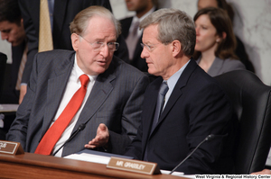 "[""Senator John D. (Jay) Rockefeller and Senator Max Baucus chat during an executive session of the Finance Committee to consider health care reform legislation.""]%"