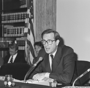 "[""Senator John D. (Jay) Rockefeller speaks into the microphone at a Senate committee hearing.""]%"