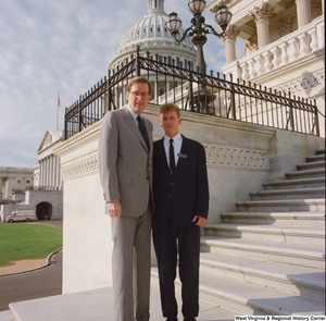 "[""Senator John D. (Jay) Rockefeller stands next to a Senate Page on the steps to the Senate.""]%"