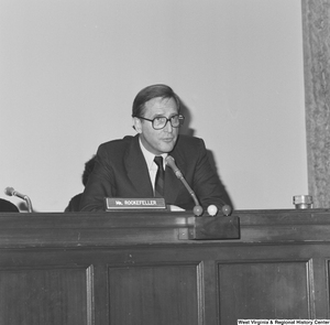 "[""Senator John D. (Jay) Rockefeller sits behind the desk at a Senate committee hearing.""]%"