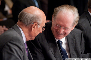 "[""Senators John D. (Jay) Rockefeller and Pat Roberts speak during an open executive session to consider healthcare legislation.""]%"