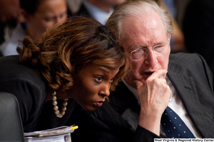 "[""Senator John D. (Jay) Rockefeller speaks with an adviser during a Finance Committee executive session about health care reform.""]%"