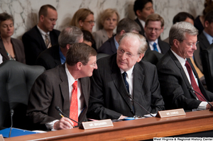 "[""Senator John D. (Jay) Rockefeller speaks with Senator Conrad Kent during an executive session about health care reform.""]%"