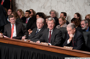 "[""Senator John D. (Jay) Rockefeller and other Senators sit during a Finance Committee executive session to consider a health care reform bill.""]%"