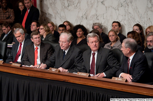 "[""A group of Senators sit during a Finance Committee hearing about health care reform.""]%"