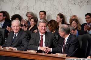 "[""Senators Max Baucus and Charles Grassley shake hands during a Finance Committee hearing about health care reform legislation.""]%"
