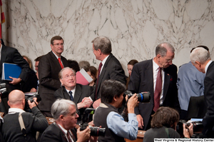 "[""Senators John D. (Jay) Rockefeller and Max Baucus shake hands after a Finance Committee hearing.""]%"