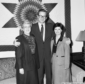 "[""Senator John D. (Jay) Rockefeller stands for a photograph with two unidentified women.""]%"