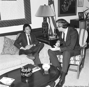 "[""Senator John D. (Jay) Rockefeller sits on a chair in his office and speaks with an unidentified individual.""]%"