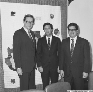 "[""Senator John D. (Jay) Rockefeller stands next to two representatives of the Independent Oil and Gas Association of West Virginia.""]%"