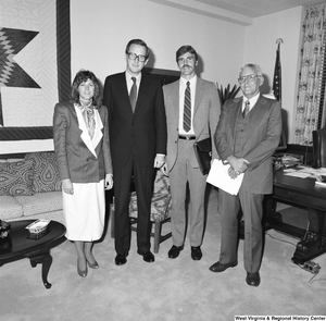 "[""Senator John D. (Jay) Rockefeller stands for a photograph with three unidentified guests in his Washington office.""]%"