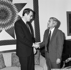 "[""Senator John D. (Jay) Rockefeller shakes hands with an unidentified guest in his office.""]%"