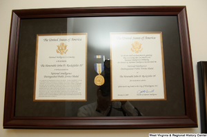 "[""Senator John D. (Jay) Rockefeller's National Intelligence Distinguished Public Service Medal award hangs on a wall in his office.""]%"