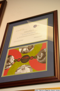 "[""A framed certificate celebrating the E-Rate Program's 10th anniversary hangs on a wall in Senator John D. (Jay) Rockefeller's office.""]%"