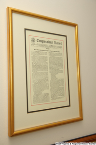 "[""A framed Congressional Record where Senator John D. (Jay) Rockefeller celebrates the birth of his first grandchild hangs in his office.""]%"