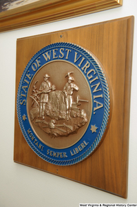 "[""The state seal of West Virginia hangs on a wall in Senator John D. (Jay) Rockefeller's office.""]%"