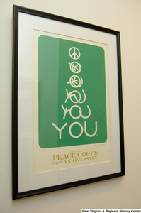"[""A 50th anniversary poster for the Peace Corps hangs on a wall in Senator John D. (Jay) Rockefeller's office.""]%"