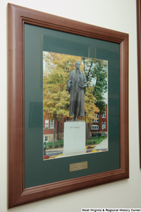 "[""A framed photograph of a John Marshall statue hangs on a wall in Senator John D. (Jay) Rockefeller's office.""]%"
