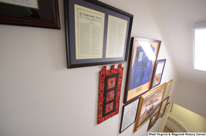 "[""This photo shows items hanging in the stairwell of Senator Rockefeller's office.""]%"