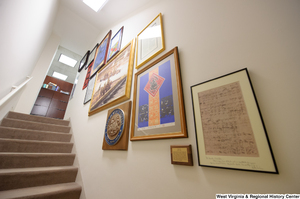 "[""Items line the stairwell in Senator John D. (Jay) Rockefeller's office.""]%"