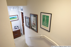 "[""Three photos hang on the wall at the bottom of the stairs in Senator John D. (Jay) Rockefeller's office.""]%"