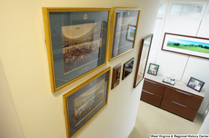 "[""Several framed items hand on the wall at the bottom of the stairwell in Senator John D. (Jay) Rockefeller's office.""]%"