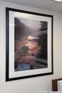 "[""A photo of a stream hangs in Senator John D. (Jay) Rockefeller's office.""]%"