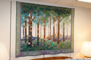 "[""A colorful forest quilt hangs in Senator John D. (Jay) Rockefeller's office.""]%"