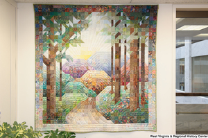 "[""A quilt showing trees and mountains hangs in Senator John D. (Jay) Rockefeller's office.""]%"
