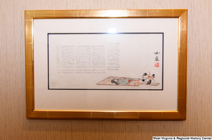 "[""Japanese character writing hangs on the wall in Senator Rockefeller's office.""]%"