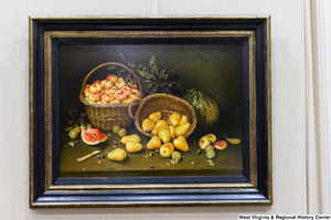 "[""A still life painting of fruit hangs on a wall in Senator Rockefeller's office.""]%"