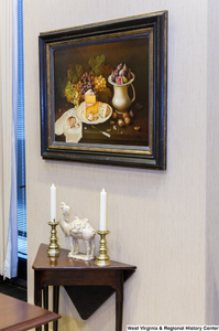 "[""A still life painting and a small table sit in Senator Rockefeller's office.""]%"